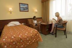 Teens in hotel room Stock Photo