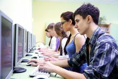 Teens In Internet-cafe Royalty Free Stock Images