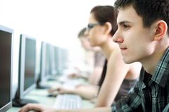 Teens in internet-cafe royalty free stock photos