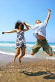 Teens jumping. At the sea stock images