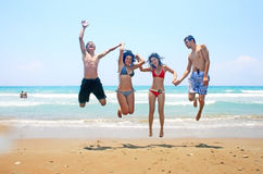 Teens jumping Royalty Free Stock Image