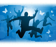 Teens jumping against a Summer background. Royalty Free Stock Images