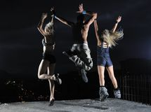 Teens jumping in air ready for party. Threen teens jumping in air representing disco and pary, joy and fun concept Stock Photo