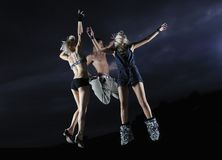 Teens jumping in air ready for party royalty free stock photography