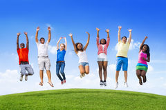 Teens Jumping On a Hill stock image