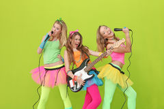 Teens karaoke party fun. Group of teens karaoke party singers with guitar and microphone having fun Royalty Free Stock Images
