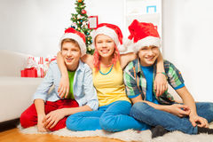 Teens kids on New year party in Santa hats Royalty Free Stock Photos
