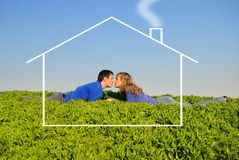 Teens kiss in a grass Royalty Free Stock Images