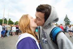 Teens kiss at water battle flashmob Stock Photos
