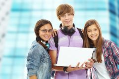 Teens with laptop Stock Photography