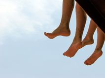Teens legs hanging Royalty Free Stock Image