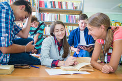Teens in library Royalty Free Stock Image