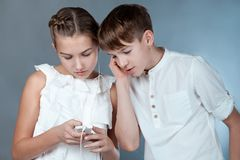 Teens listen to music with headphones Stock Images