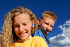 Teens listening to music royalty free stock image