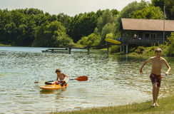 Teens on Mammendorf lake, Bavaria, Germany Royalty Free Stock Photos