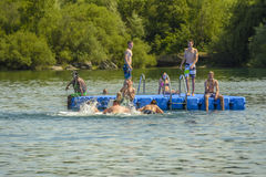 Teens on Mammendorf lake, Bavaria, Germany Stock Photos
