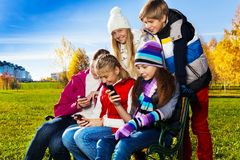 Teens occupied with gadgets Royalty Free Stock Photo