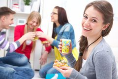 Teens party with pizza. Group of friends taking a home party with Pizza Royalty Free Stock Images