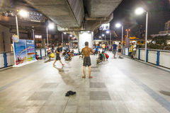 Teens perform breakdance at a train station in Bangkok Royalty Free Stock Images