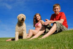 Teens with pet. Brother sister and their dog Royalty Free Stock Photography