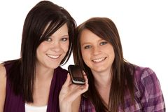 Teens with phone Stock Image