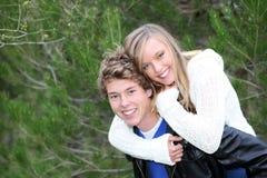 Teens piggyback. Happy smiling piggyback fun teens  couple Royalty Free Stock Photo