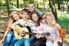 Teens playing guitar. And singing Royalty Free Stock Images