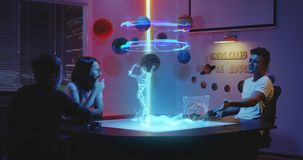Teens playing holographic game