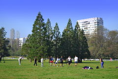 Teens playing  in urban park Stock Photography
