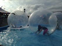Teens playing in water balls Stock Images