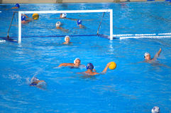 Teens playing water polo Stock Photo