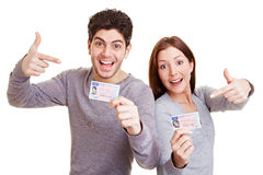 Teens pointing to drivers license Stock Photos