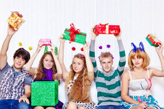 Teens with presents Royalty Free Stock Images