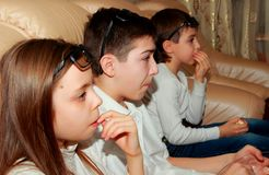 Teens in profile with interest watching movie Stock Photos