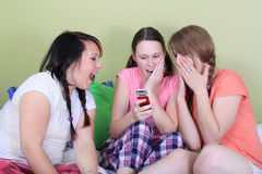 Teens reading text messages Royalty Free Stock Image