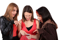 Teens reading text messages Stock Photos