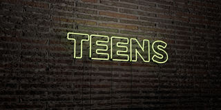 TEENS -Realistic Neon Sign on Brick Wall background - 3D rendered royalty free stock image Stock Photography