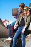 Teens relaxing in a city park Stock Images