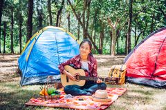Teens are relaxing with play guitar in the picnic area. Teens are relaxing with play guitar in the picnic area stock photos