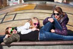 Teens relaxing on a street Royalty Free Stock Photo