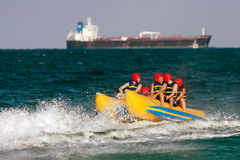 Teens Ride On Banana Boat In Florida Royalty Free Stock Image