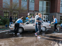 Teens run charity carwash at local high school Stock Photos