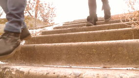 Teens run down the stairs. people`s feet stock video footage