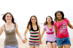 Teens running. Group of young teens running on beach Royalty Free Stock Photos