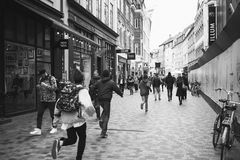 Teens running down Strøget. A group of teenagers are running down the street in Copenhagen, Denmark Stock Photos