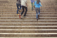 Teens running up stairs at school. Teenage friends spending time together Stock Image