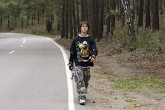 Teens with skateboard. Sport teens boy with skateboard in pine forest, park Burubay Royalty Free Stock Images