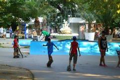Teens skateboarding in city park Stock Photo