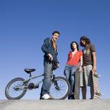Teens at skatepark. Teens hang out at the skatepark Stock Photos