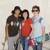 Teens at the skatepark. Three kids with skateboards hang out at the skate park Royalty Free Stock Photos